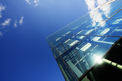 Modern building glass facade against sky
